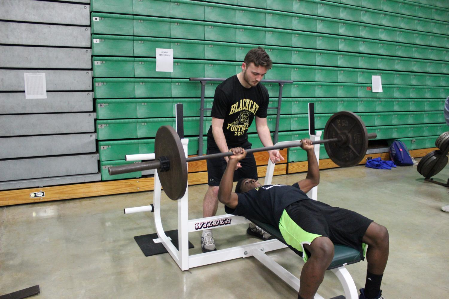 Chris Harwood spotting Malachi Kyle on Bench Press