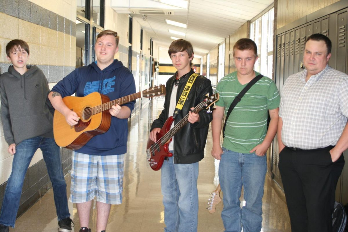 Mr.Maas, Hunter Bellew, Jacob Pinkley, Devin Martin, and Brent Turnbough pose for the camera with their guitars.