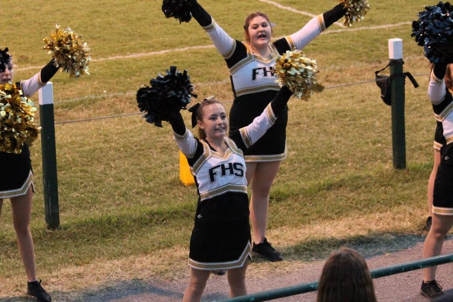 Jacquelyn Cowsert and Lanie Wade performing a cheer at an away game against Perryville