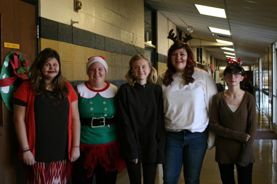 A group of students from Mr. Carver's 6th hour class dressed up for Christmas Movie Day