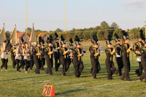 The Fredericktown Band walking out into the field