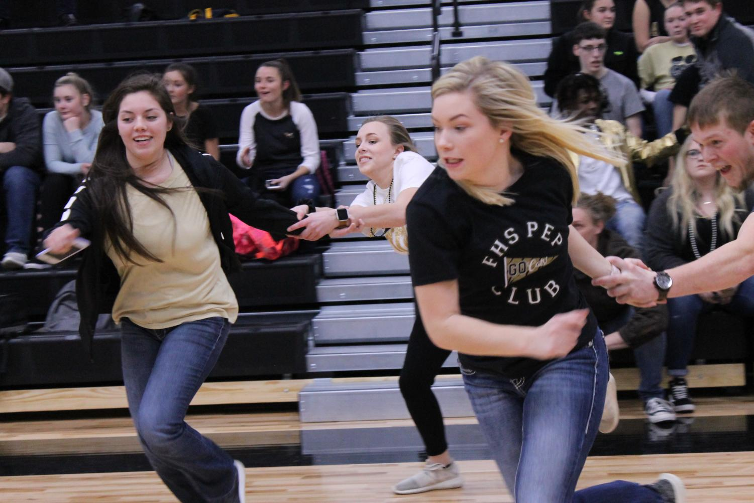 Kylie Mann and Mattie Whitworth running to win the Scavenger Hunt