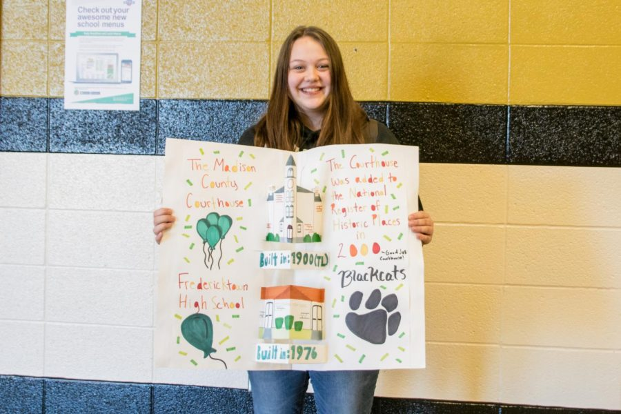 Ella Sikes holding her winning project