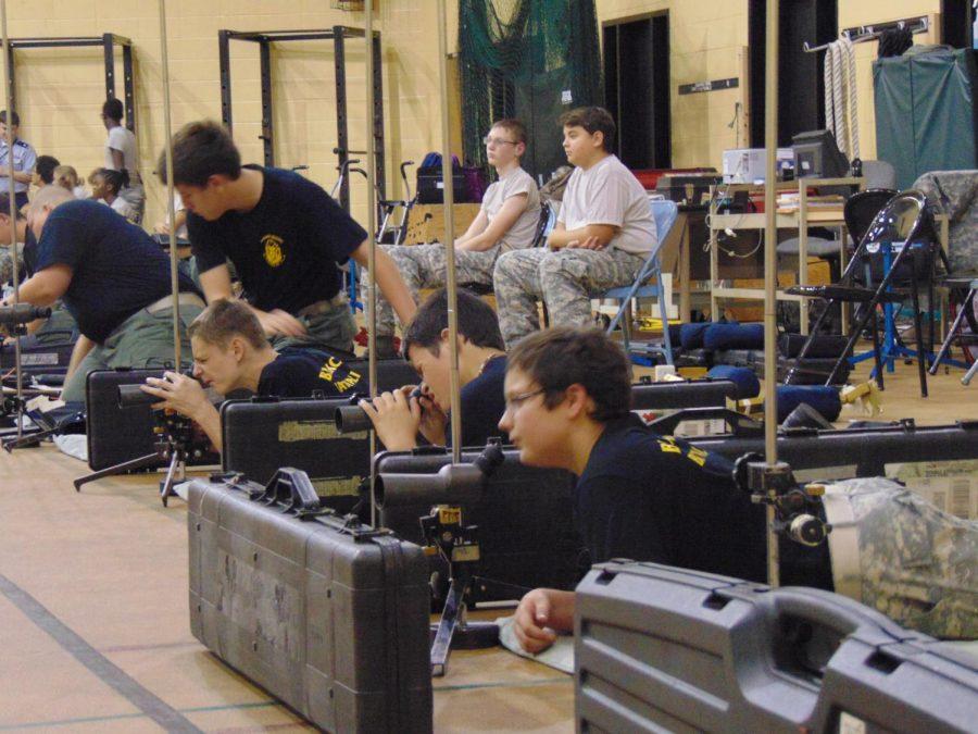 Daniel Gerler, Chris Lilley-Flick, Daniel Whitehead, and Wyatt Matkin preparing to fire from the prone position