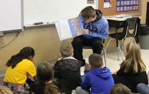 Easton Elrod reading to Mrs. Walker's class.