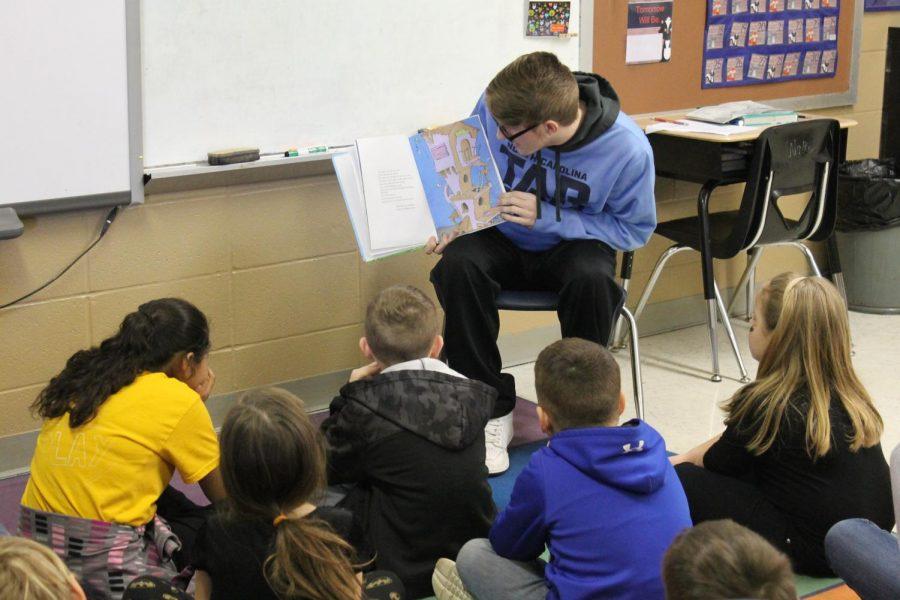 Easton Elrod reading to Mrs. Walker's class.