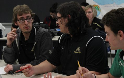 Cody Phillips and Carter Corcino discuss answers during a bonus round.