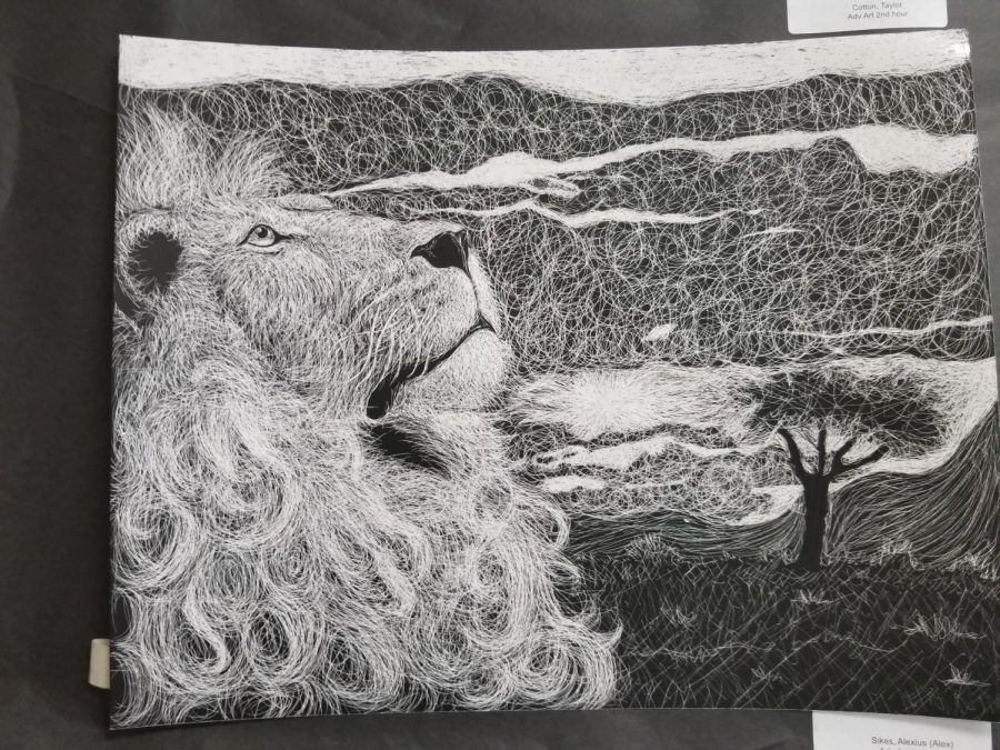 A work of art etched in black paper by Alexius Sikes. The advanced art class was prompted to make a white picture by carving into black paper.