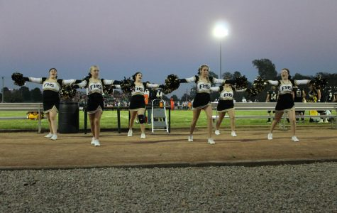 The squad is in perfect sync at a home game against Perryville