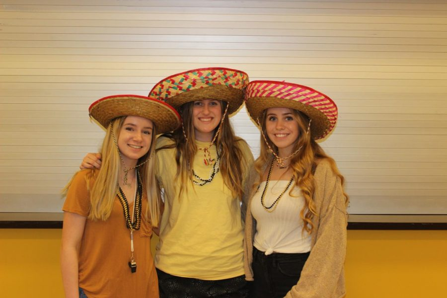 Hayliegh Locke, Anja Francis, Kristen Mungle dressed up for black and gold day.