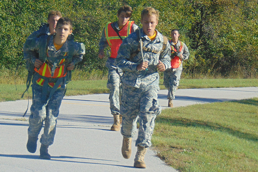 Caleb Cooper and Blake Olson lead out on the 10k run. Team members Jerritt Hargis, Caileb Queener, and Levi Barlow must also finish before the team's time is called. Jeff Wilson, Aaron Cooper, Levi Cooper were also running, but they are not pictured here.