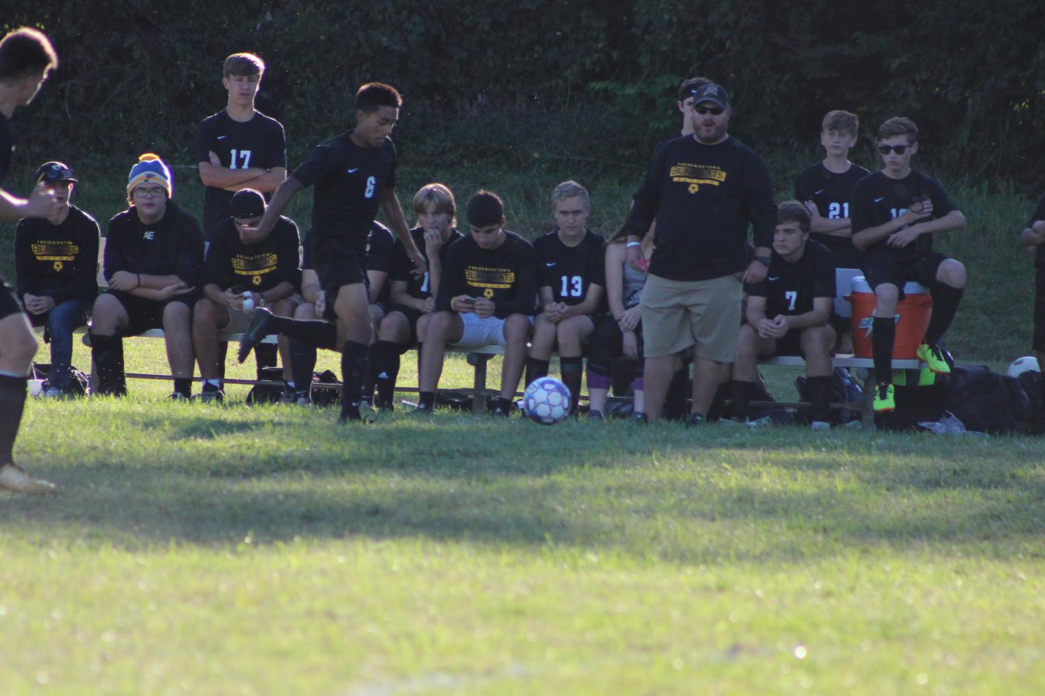 The FHS Soccer team sitting during a game
