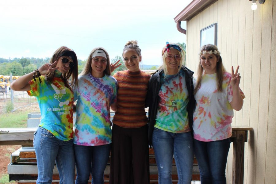 Abi McCollom. Kylee Bastie, Katelyn White, Rilee Minx, and Ashely Yoder dressed up for hippie day