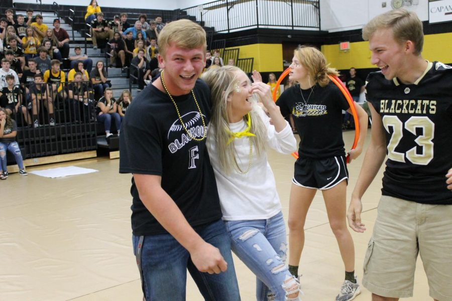 Colton Rehkop, Blayke Maxwell, and Dylan St. Clair laughing while playing in the scavenger hunt.