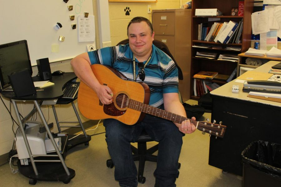 Mr. Maas showing off his acoustic guitar.