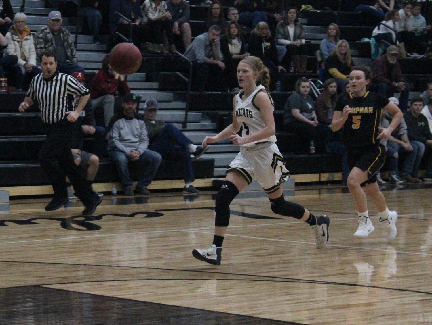 Marissa Hale runs to recover the ball at a home game against Doniphan.