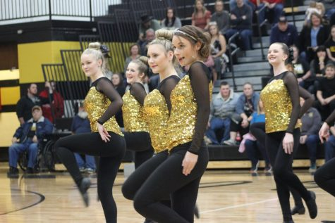 Mackenzie Phillips, Skylar Sikes, and Hope Turnbeau dancing their jazz routine at Homecoming