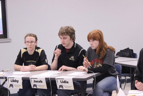 (From left to right) Libby Mooney, Jacob Mungle, and Lidia Myers answering the tough questions at a meet in February.