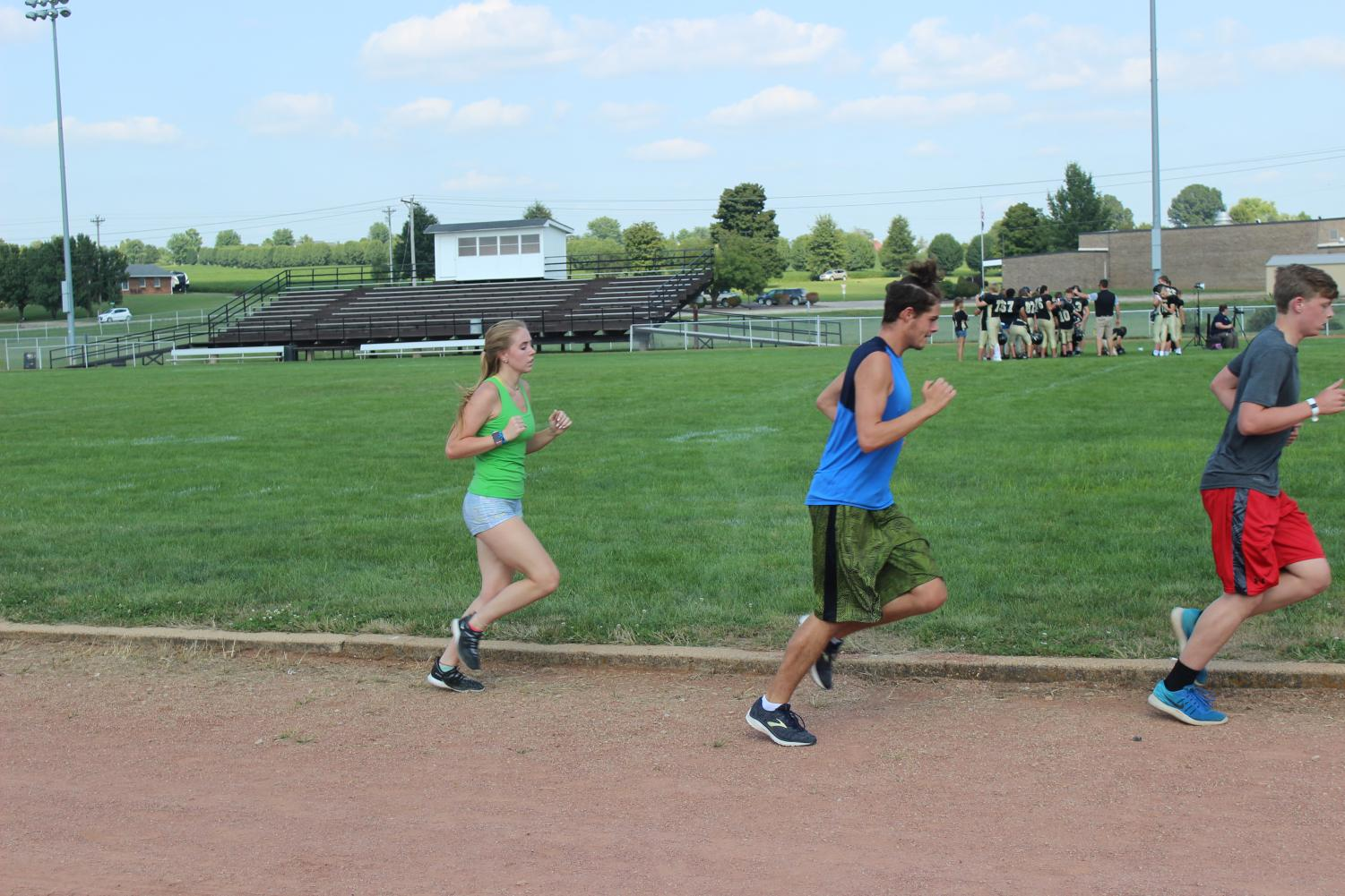 (left to right) Kristen Mungle, Dwayne Kemper and Clayton Martin putting in hard work at their practice.