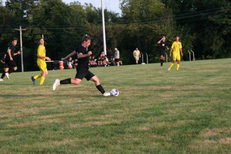 Senior Jeddidiah Dewey kicks the ball to the opponents goal during a home game against Saxony Lutheran