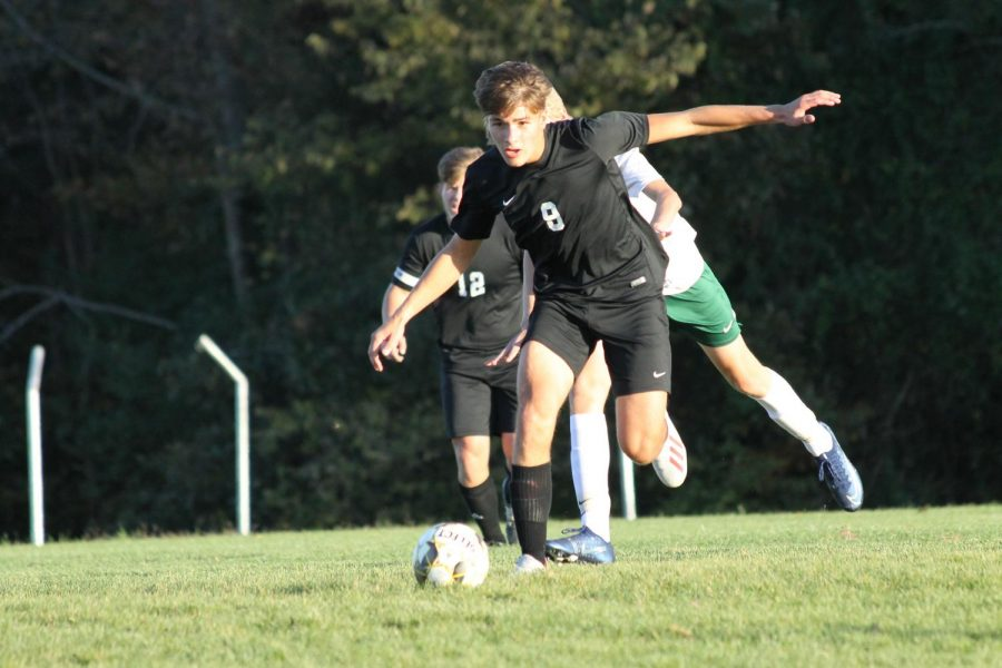 Junior Dawson Buford, 9, dribbles the ball towards Perrville's goal.
