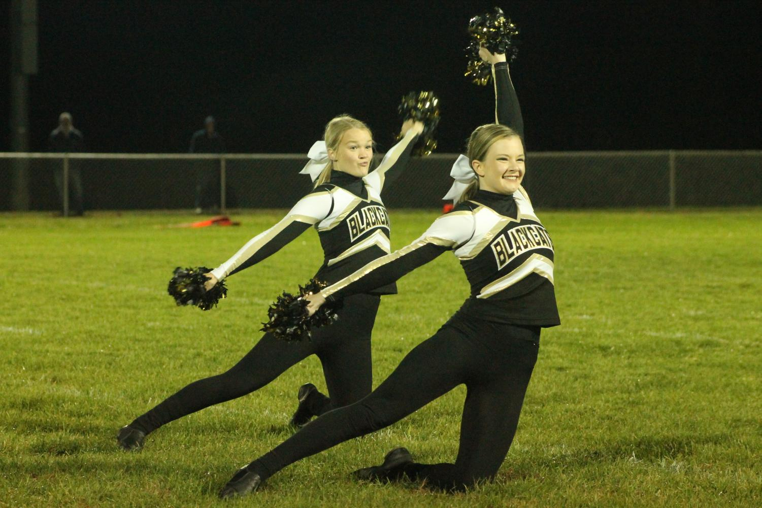 Mackenzie Rice (12) and Maddie Jennings (11) preforming during Football Homecoming