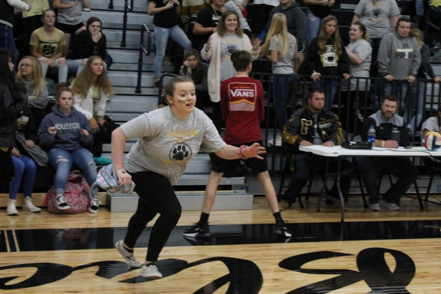 Sophomore, Jamie Barber running back to her hoop after successfully obtaining her object.