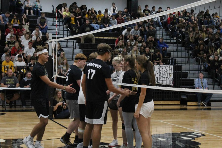 The senior team shaking their opponents' hands after winning against them.
