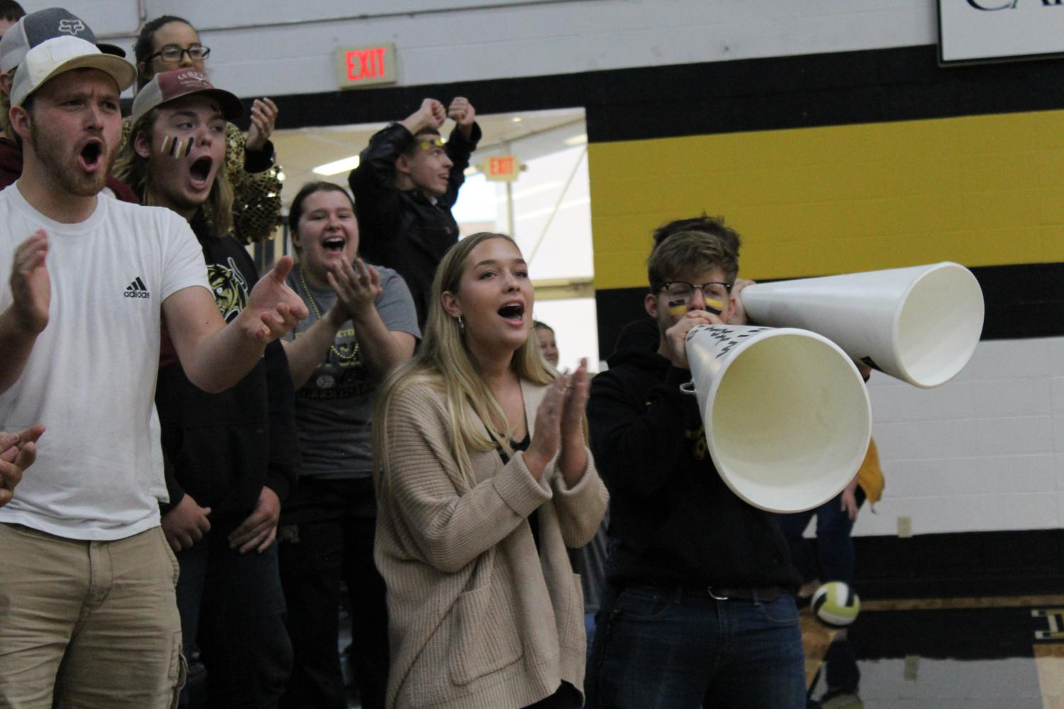 The seniors cheering very energetically.