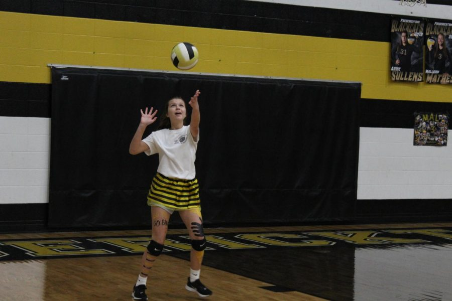 Lizzy Crouch, freshman, serving the ball.