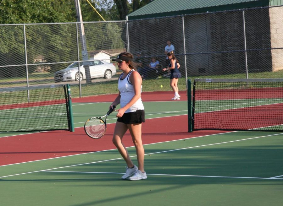 Sophomore Sophie Rehkop retrieve the ball during one of her matches.
