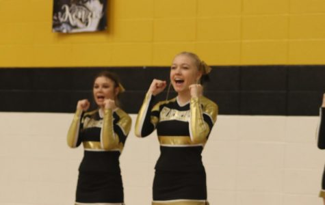 Mayce Seabaugh (11) performing their score cheer