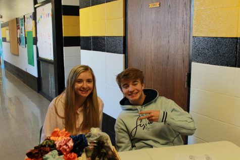 While students are at first lunch, Alyssa Pierson and Colton Francis take time out of their leadership class to sell scrunchies.