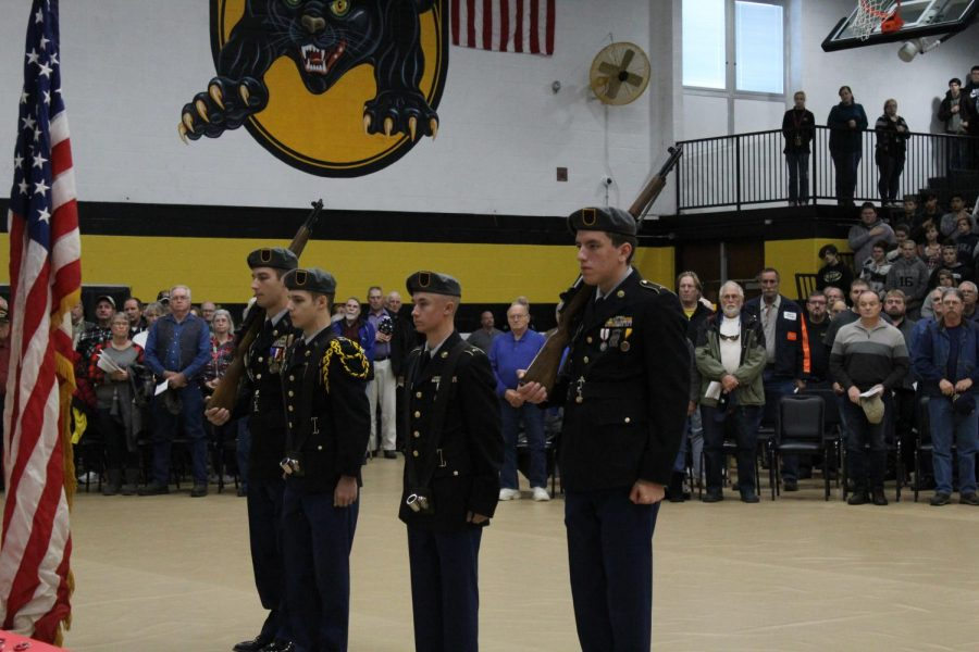 The color guard presenting the flags.