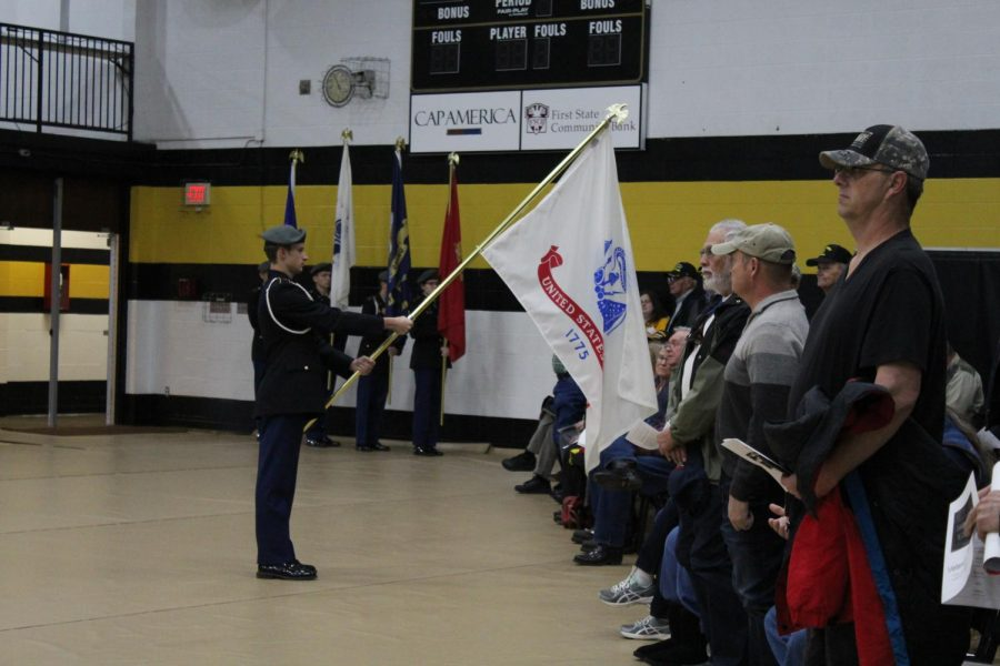 Cadet Hart presenting the National Guard flag.