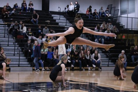 """Welcome to the Jungle"" was incorporated with many moves and stunts that amazed the viewers. Mackenzie Rice does an incredible toe touch while simultaneously winking at the crowd, followed by other members of her team also doing something special to add to the piece."