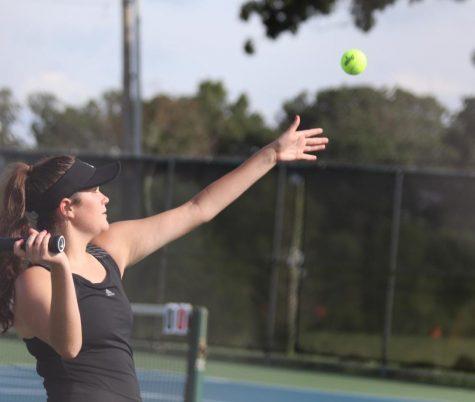 Sophie Rehkop (11) serving 30-15 against Farmington