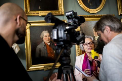 Olga Botner interviewed at a press conference at the Royal Swedish Academy of Sciences.