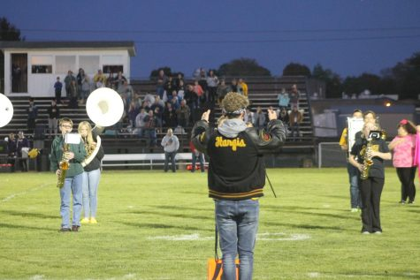 Jerritt Hargis directing the band during their halftime performance.