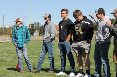 The Mr. Blackcat candidates stand waiting for their competitions to begin with varying levels of confidence.  From left to right, Shane Miller (10), Eli Aslinger (10), Huston Bradford (12), Braden Lee (12), Conner Brotherton (11), and Josh Hunt (11).