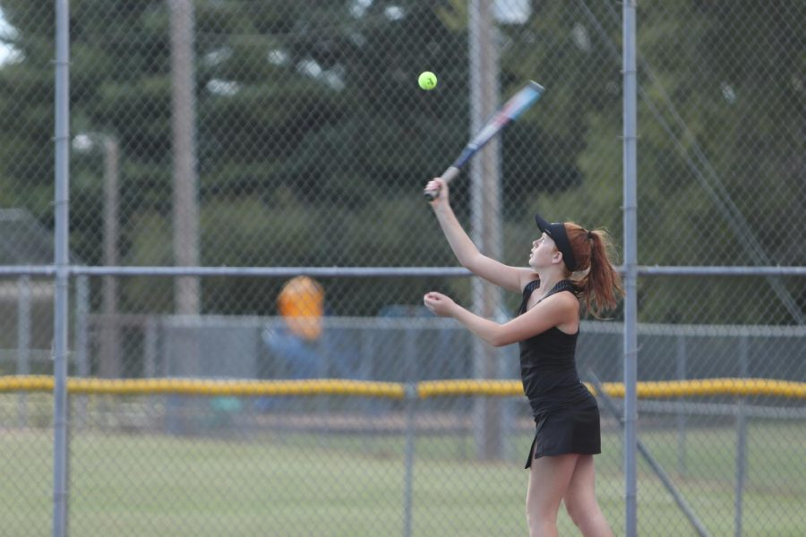 Grace Lewis on her last serve of her singles game against Sikeston, gaining a win for her team.