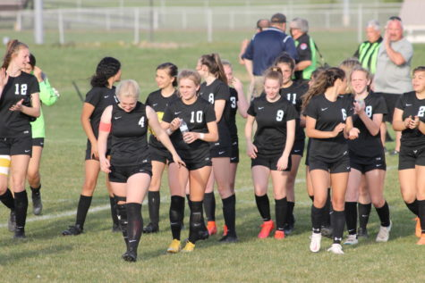 The girls soccer team leaving the field after farmington left after half time.