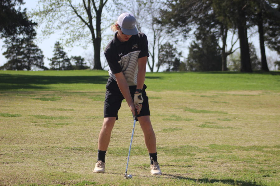 Wesley Dulany (9) lining up to drive the ball towards the hole.