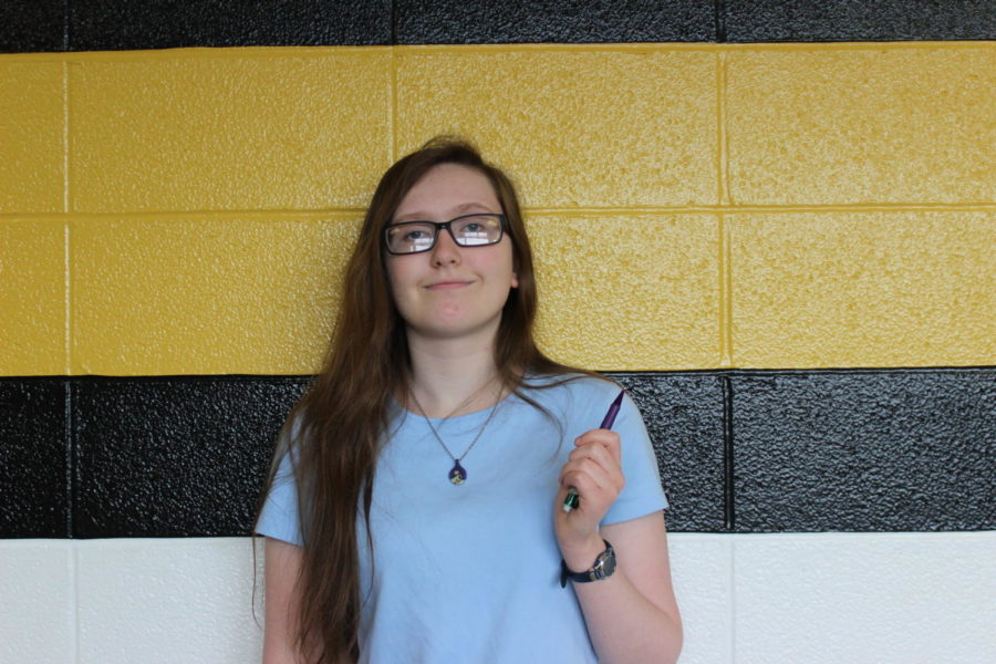 Author, Abi Stookey (11), posing for a picture with her favorite pencil.