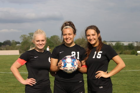 Arika Buxton, Loren Kinkead, and Brezlyn Boswell posing for a picture after they got recognized on senior night.