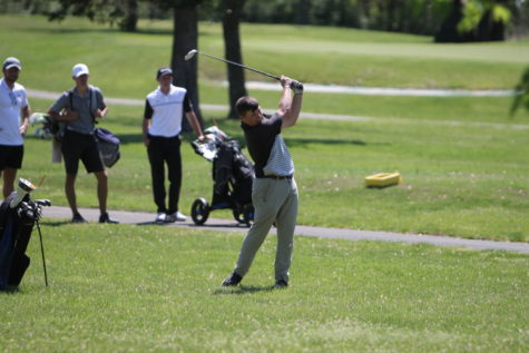 Garrett Ward (10) driving the golf ball on his 2nd shot for the hole.