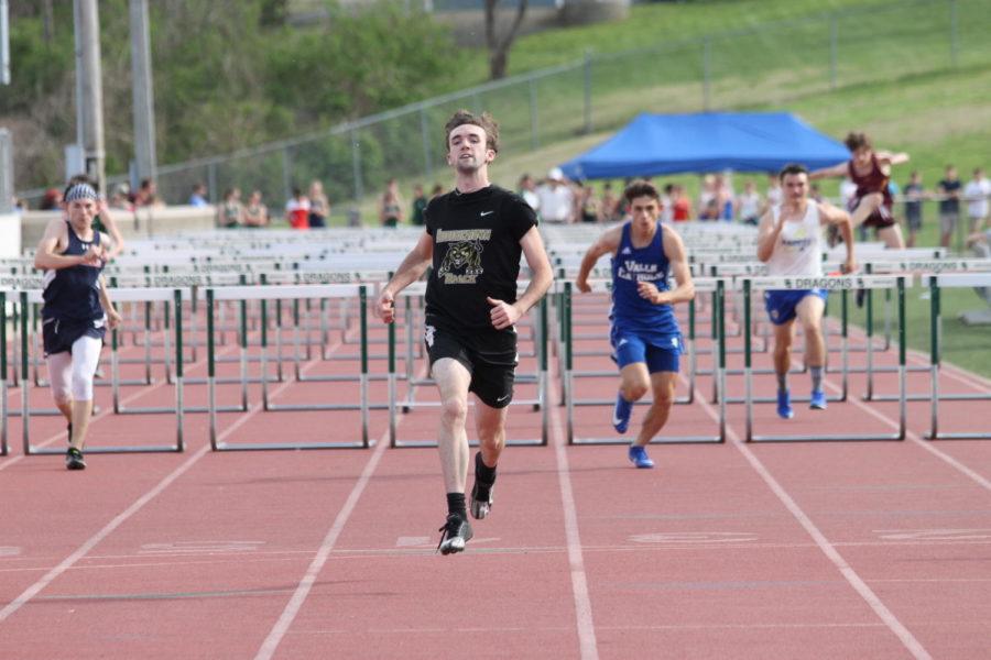 Patrick Sikes (12) leaving other teams in the dust during the  100m hurdles.