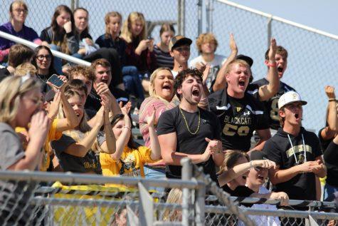 Seniors cheering for Josh Hunt (12) during Mr. Blackcat.