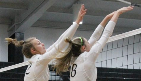 Kyndal Dodd (12) and Ryleigh Gresham (11) blocking the ball from meadow heights #12 (Allie Bloom)
